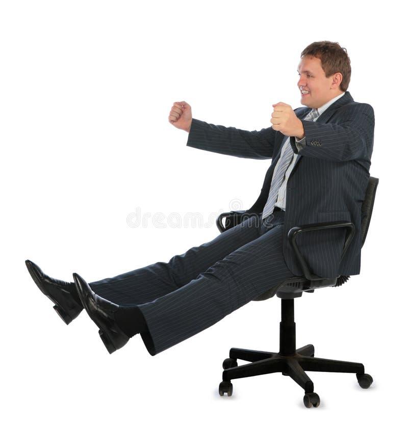 Homem de negócios de condução feliz na cadeira fotos de stock royalty free