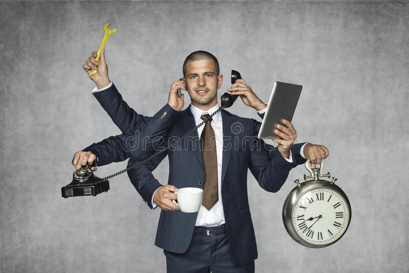 Homem de negócios de múltiplos propósitos fotografia de stock