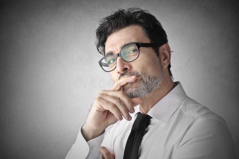 Homem de negócios de pensamento fotos de stock royalty free