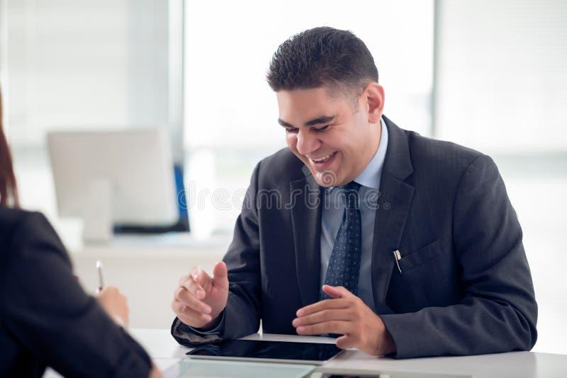 Homem de negócios de riso imagem de stock royalty free