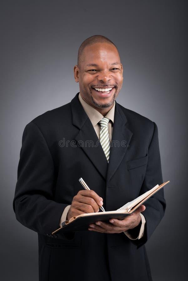 Homem de negócios de riso fotos de stock royalty free