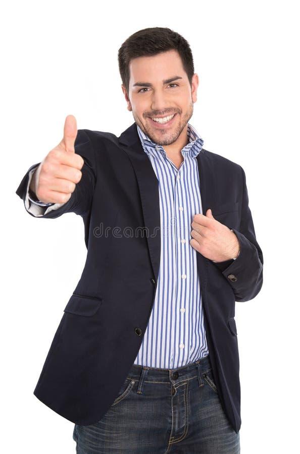 Homem de negócios de sorriso bem sucedido atrativo isolado com polegar acima foto de stock