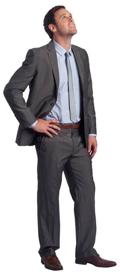 Homem de negócios de sorriso com mão no quadril imagem de stock royalty free