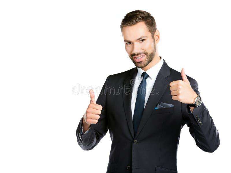 Homem de negócios de sorriso com polegares acima fotografia de stock royalty free