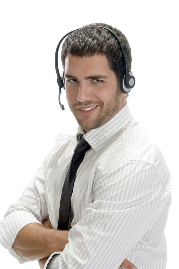 Homem de negócios de sorriso que levanta com auriculares imagens de stock