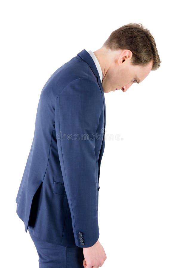 Homem de negócios derrotado que olha para baixo fotos de stock royalty free