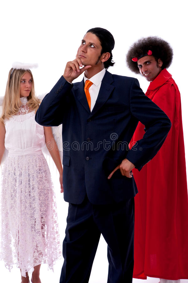 Homem de negócios, diabo e anjo imagens de stock