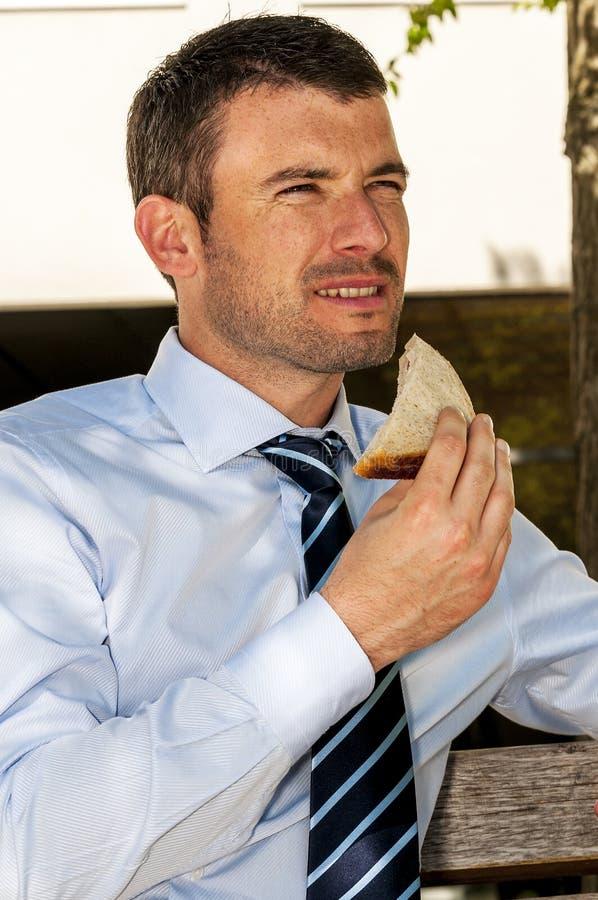 Homem de negócios do sanduíche foto de stock royalty free