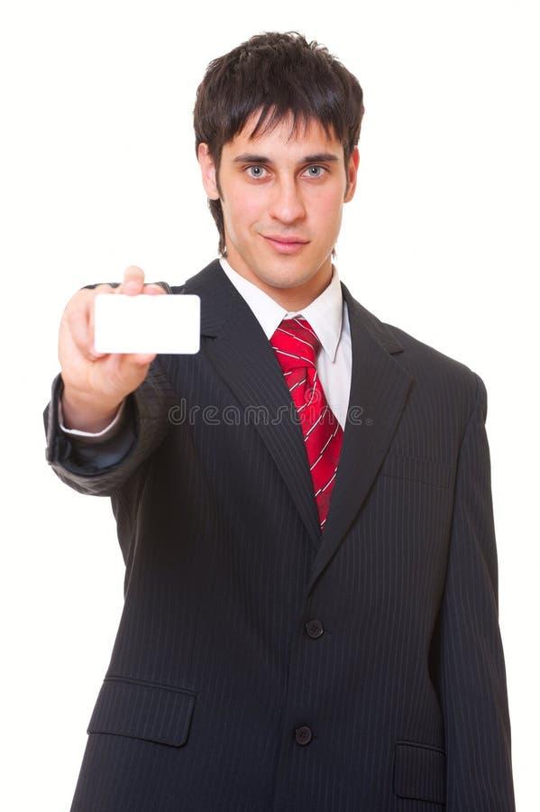Homem de negócios do smiley que mostra o cartão imagens de stock royalty free