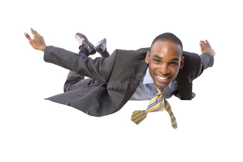 Homem de negócios do voo foto de stock