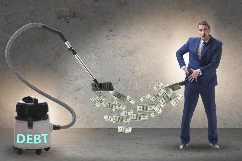 Homem de negócios e aspirador de p30 que suga o dinheiro fora dele fotografia de stock royalty free