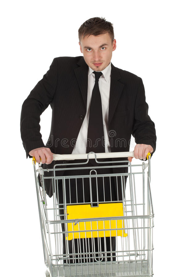 Homem de negócios e carro de compra fotografia de stock royalty free