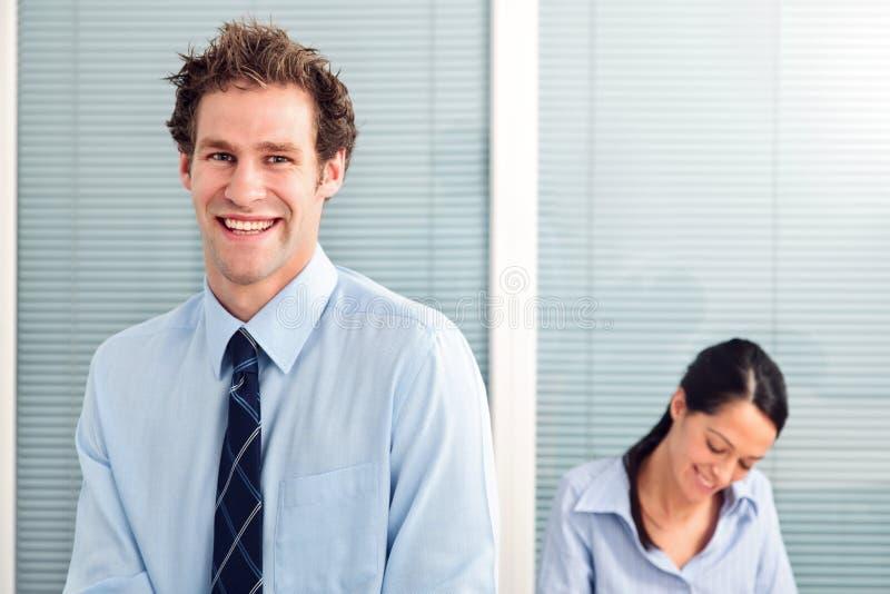 Homem de negócios e colega. imagens de stock