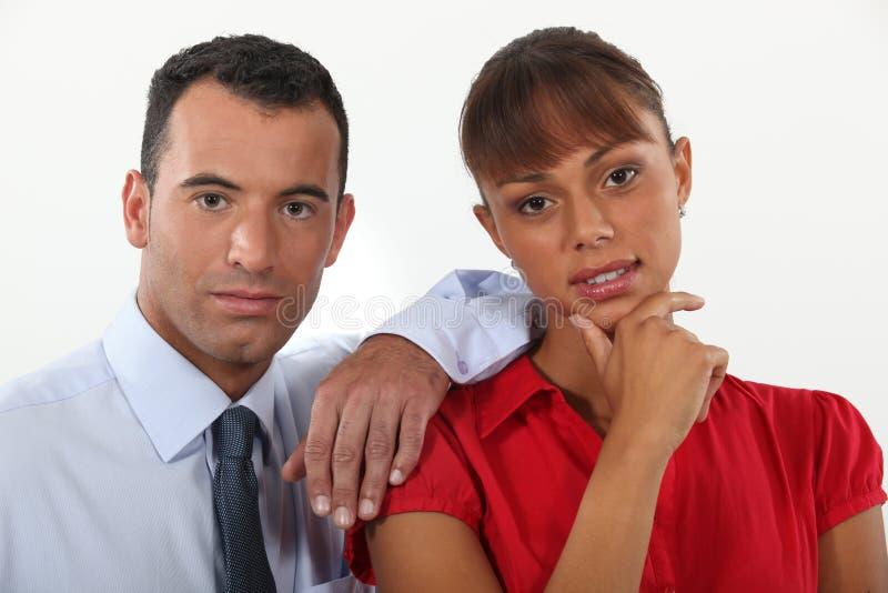 Homem de negócios e mulher de negócios novos fotografia de stock