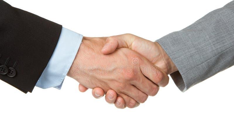 Homem de negócios e mulher de negócios que agitam as mãos fotografia de stock
