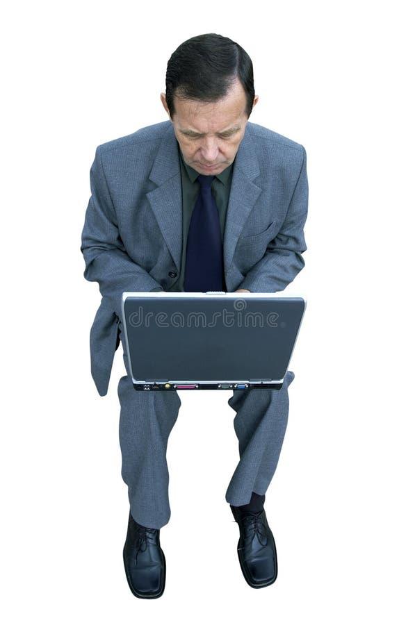 Homem de negócios e portátil isolados imagens de stock royalty free