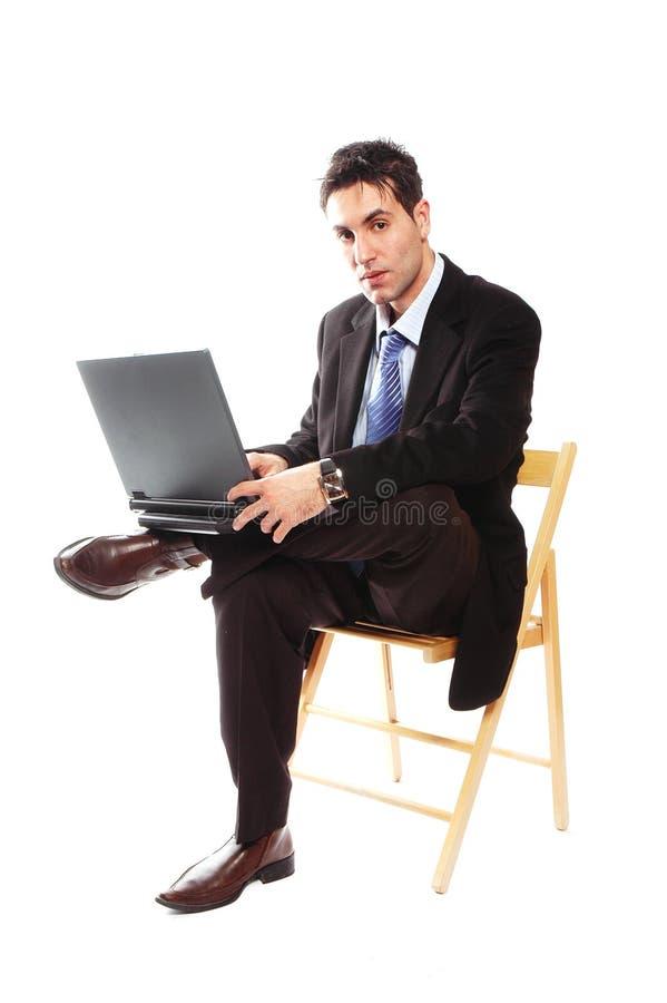 Homem de negócios e seu portátil imagem de stock royalty free