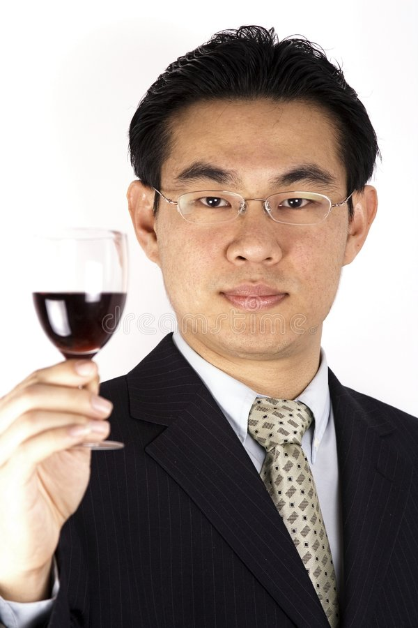 Homem de negócios e vinho chineses imagem de stock royalty free