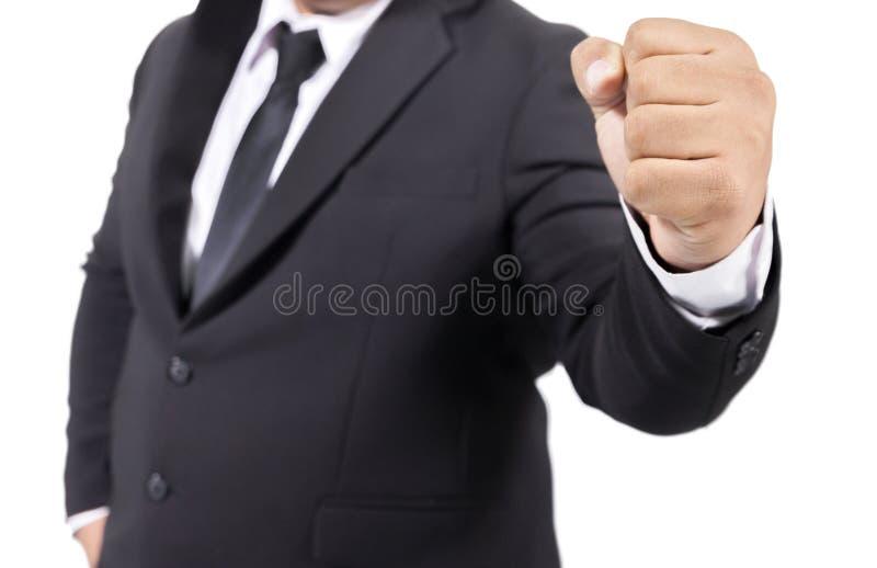Homem de negócios em um punho da mão do terno isolado foto de stock