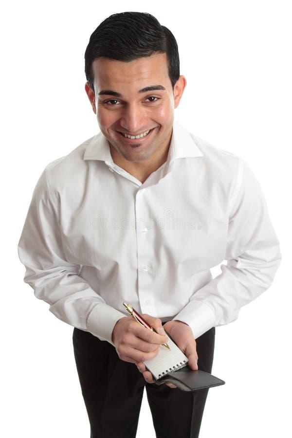 Homem de negócios, empregado de mesa etc. com pena e bloco de notas felizes imagens de stock