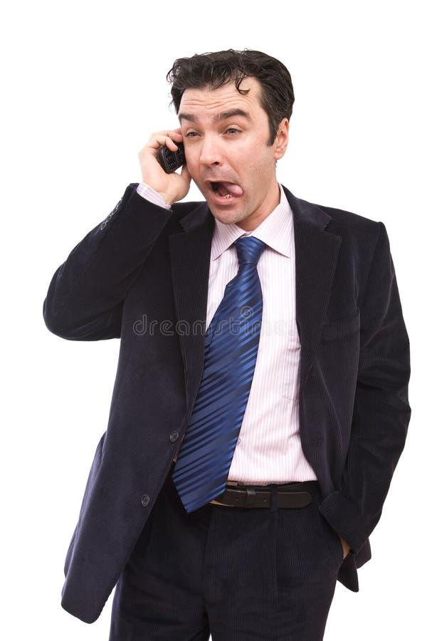 Homem de negócios engraçado no telefone imagens de stock