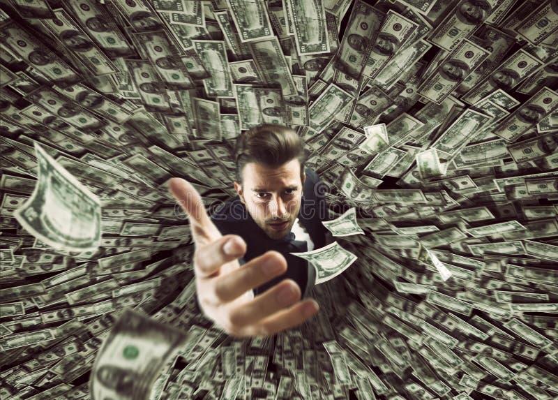Homem de negócios engulido pelo buraco negro do dinheiro imagem de stock royalty free