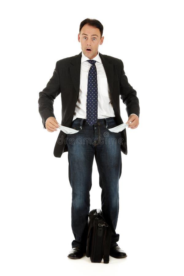 Homem de negócios envelhecido médio, bolsos foto de stock royalty free