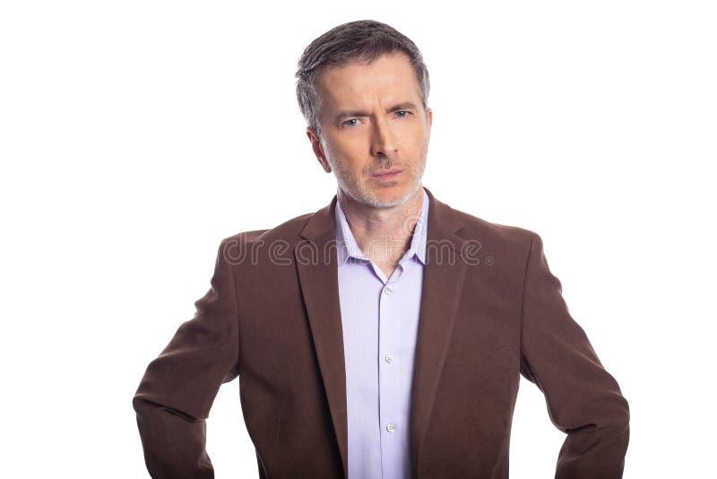 Homem de negócios envelhecido médio Looking Angry ou virada imagem de stock royalty free