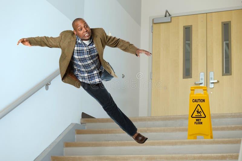 Homem de negócios Falling no vão das escadas fotos de stock royalty free
