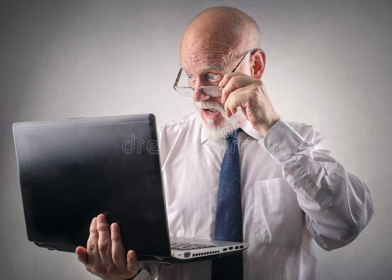 Homem de negócios fascinado imagens de stock