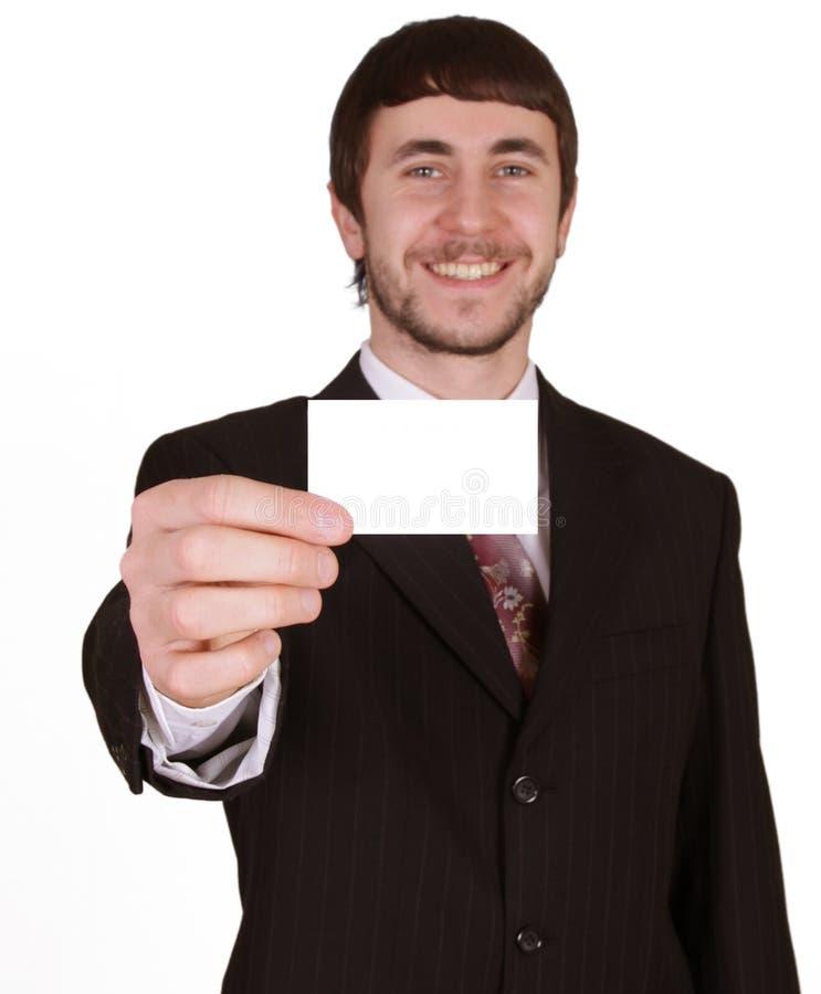 Homem de negócios feliz com cartão em branco imagem de stock