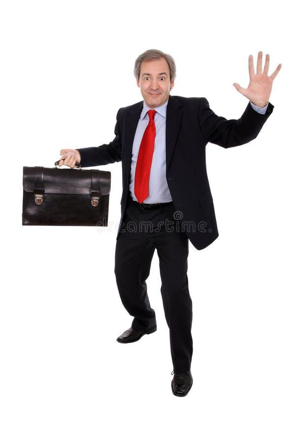 Homem de negócios feliz com uma pasta imagens de stock