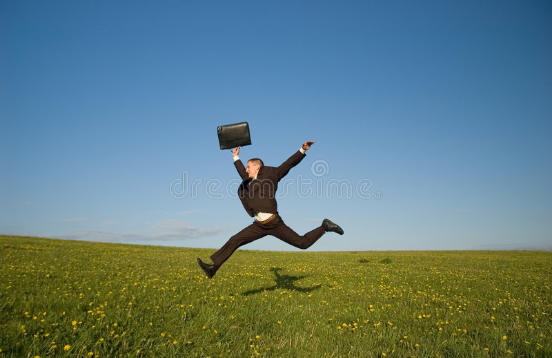 Homem de negócios feliz de salto imagem de stock royalty free