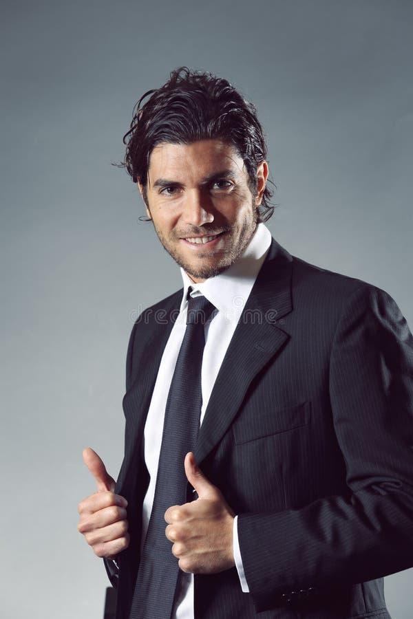Homem de negócios feliz e sorrindo fotografia de stock