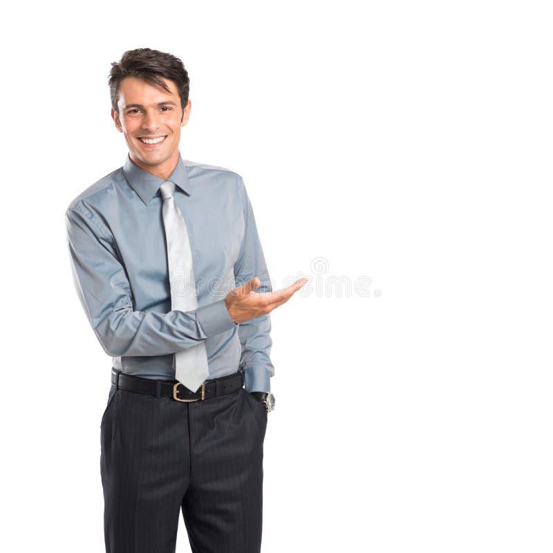 Homem de negócios feliz Presenting foto de stock