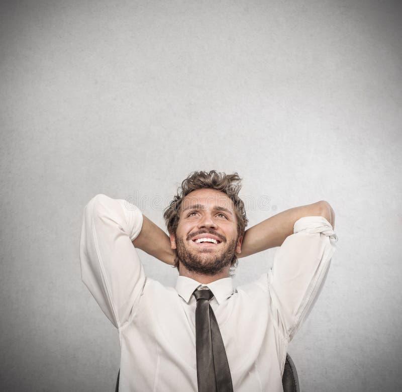 Homem de negócios feliz que relaxa-se imagens de stock royalty free