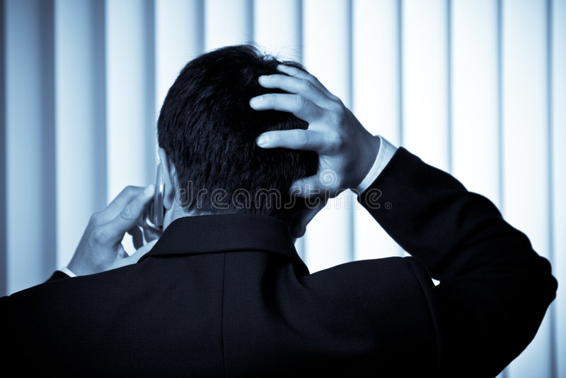 Homem de negócios forçado foto de stock royalty free