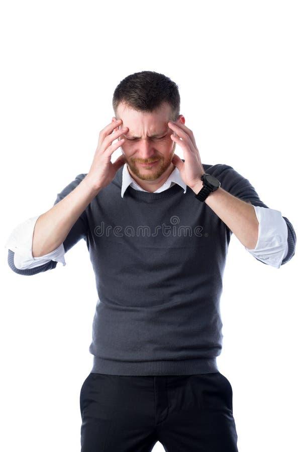 Homem de negócios forçado com dor de cabeça foto de stock