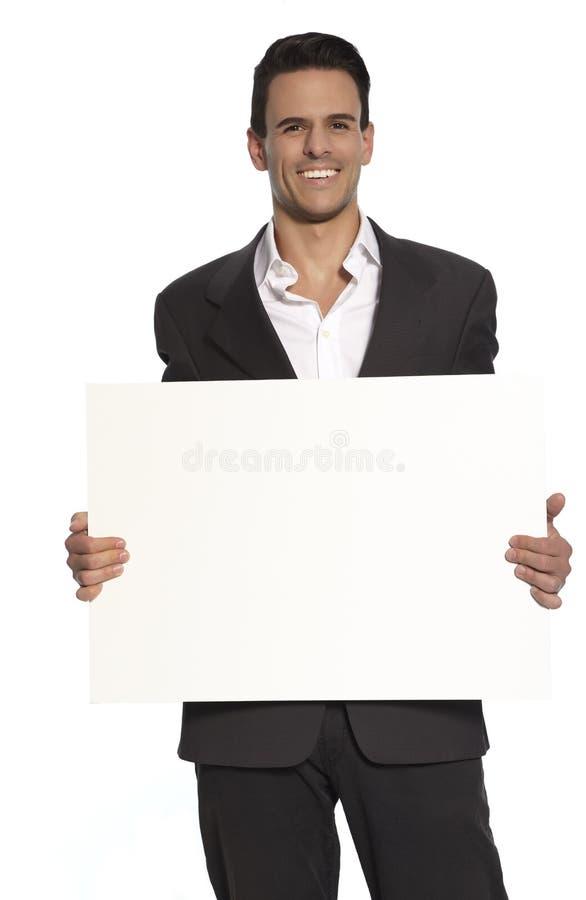 Homem de negócios Holding Sign imagem de stock
