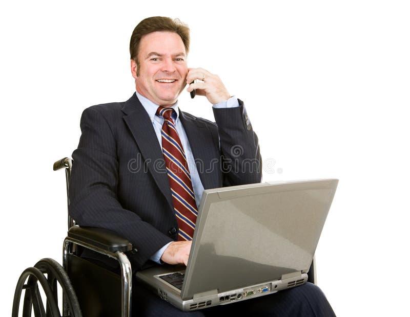 Homem de negócios incapacitado no telemóvel imagens de stock royalty free