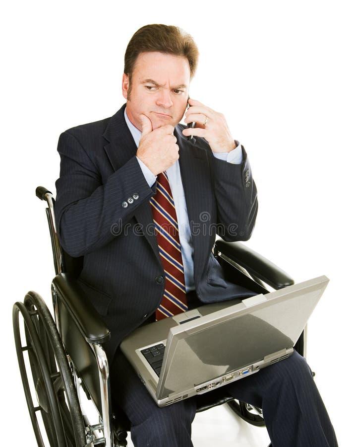 Homem de negócios incapacitado - pensando foto de stock royalty free