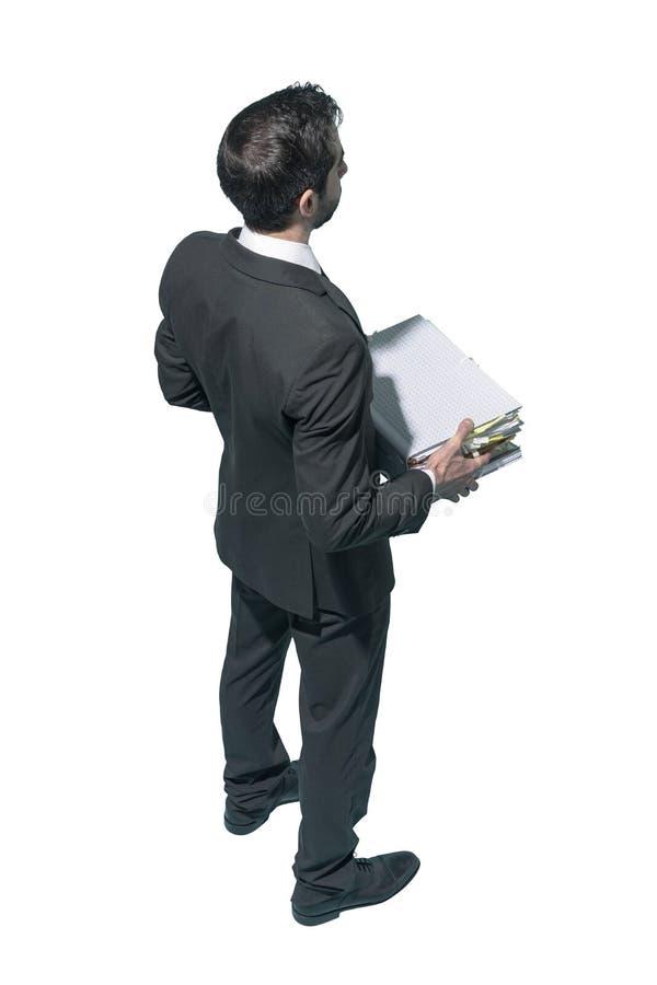 Homem de negócios incorporado que guarda uma pilha do documento imagens de stock