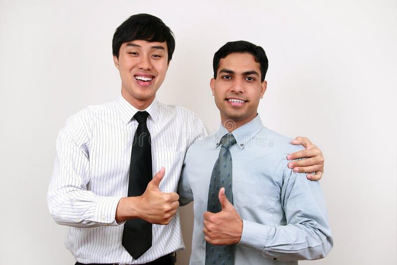 Homem de negócios indiano e chinês. imagem de stock royalty free
