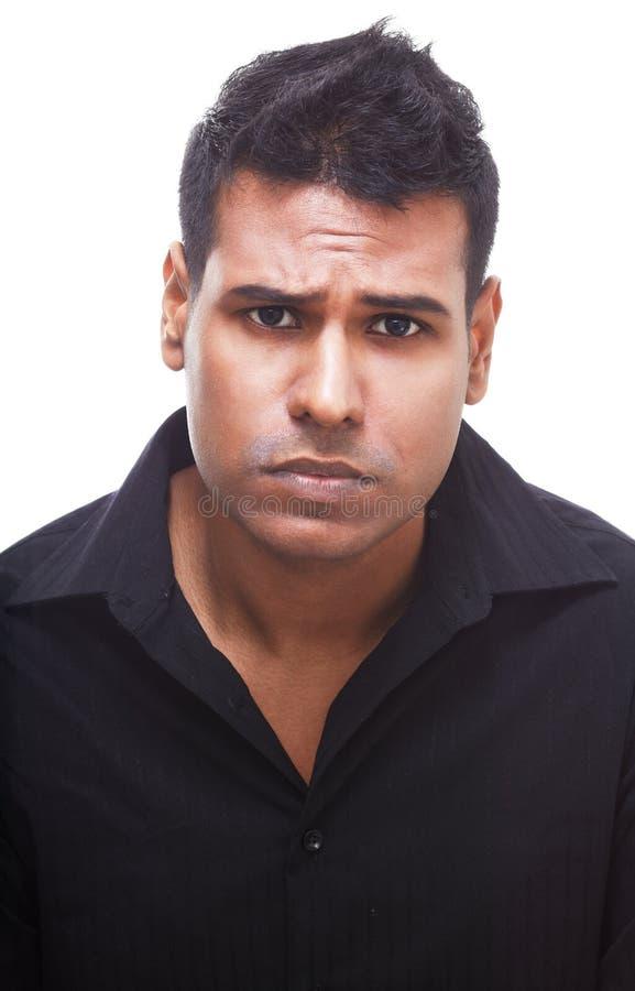 Homem de negócios indiano virado que olha de sobrancelhas franzidas e decepcionado fotografia de stock