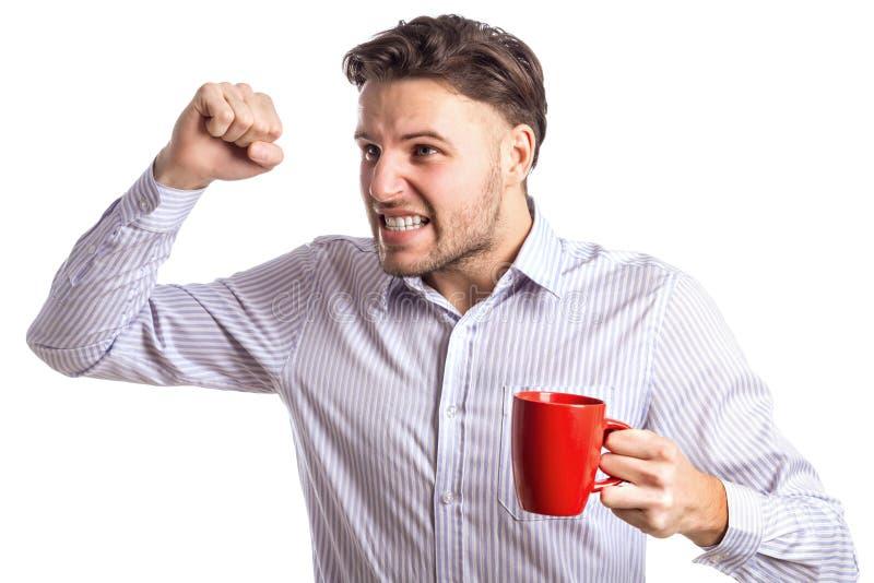 Homem de negócios irritado considerável Brandishing His Fist que guarda o copo vermelho fotografia de stock