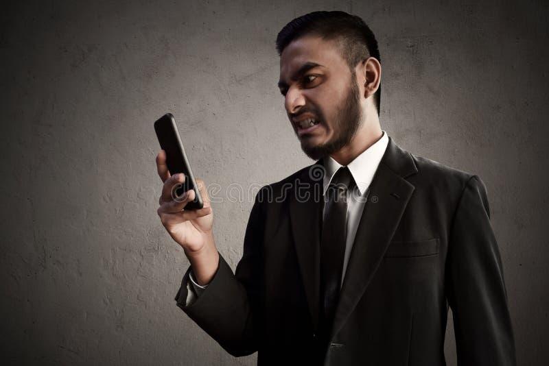 Homem de negócios irritado e esforço foto de stock
