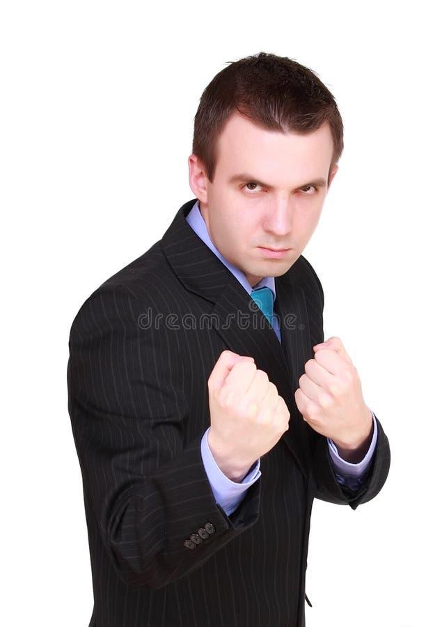 Homem de negócios irritado na posição do pugilista. Isolado foto de stock