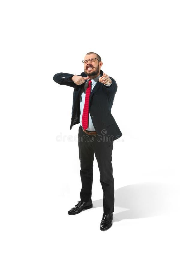 Homem de negócios irritado que ameaça e que aponta à câmera No branco fotos de stock