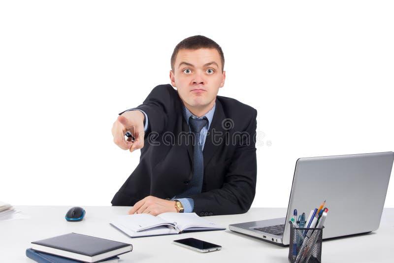 Homem de negócios irritado que aponta a parte dianteira imagem de stock