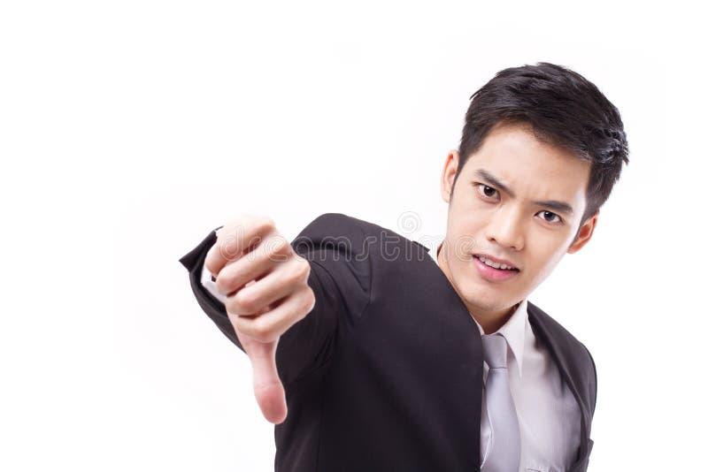 Homem de negócios irritado que dá o polegar para baixo foto de stock royalty free